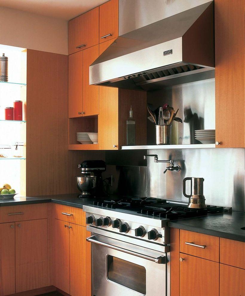 High End Ranges   Modern Kitchen  and Black Countertops Flat Medium Tone Wood Cabinets Open Shelves Pot Filler Stainless Steel Backsplash Stainless Steel Gas Range Stainless Steel Hood Vertical Grain