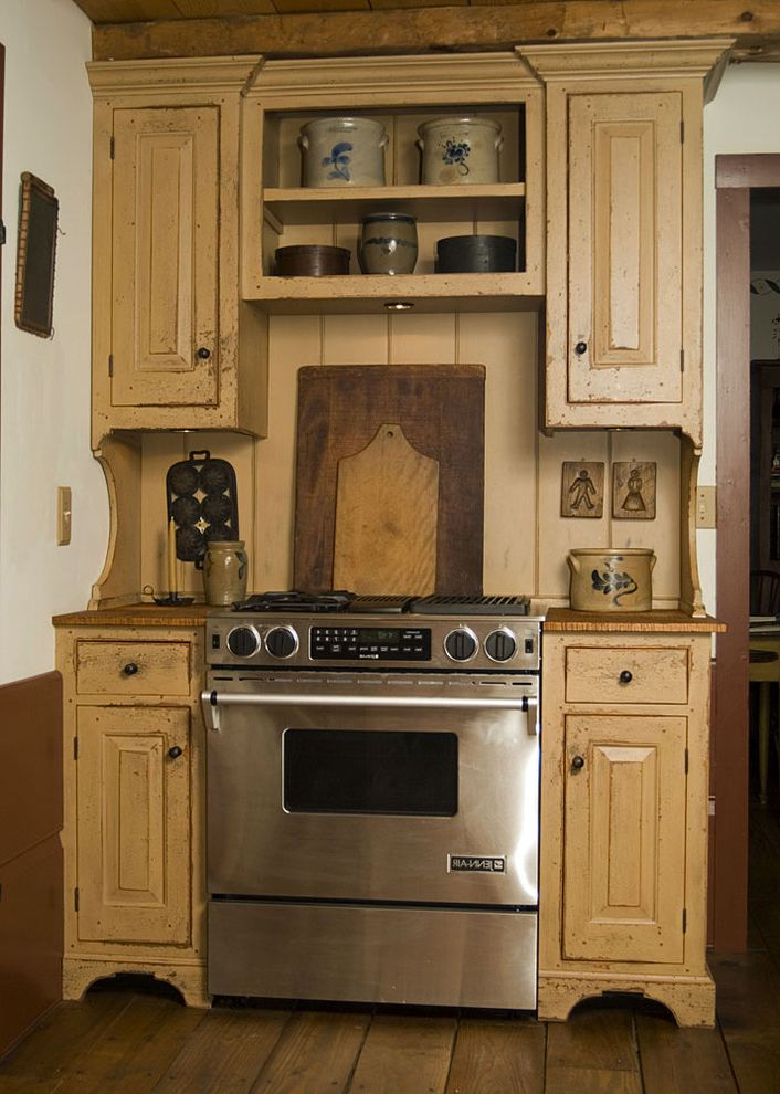 High End Ranges   Traditional Kitchen  and Built Ins Cutting Boards Distressed Wood Cabinets Open Shelves Painted Wood Wood Countertops Wood Flooring