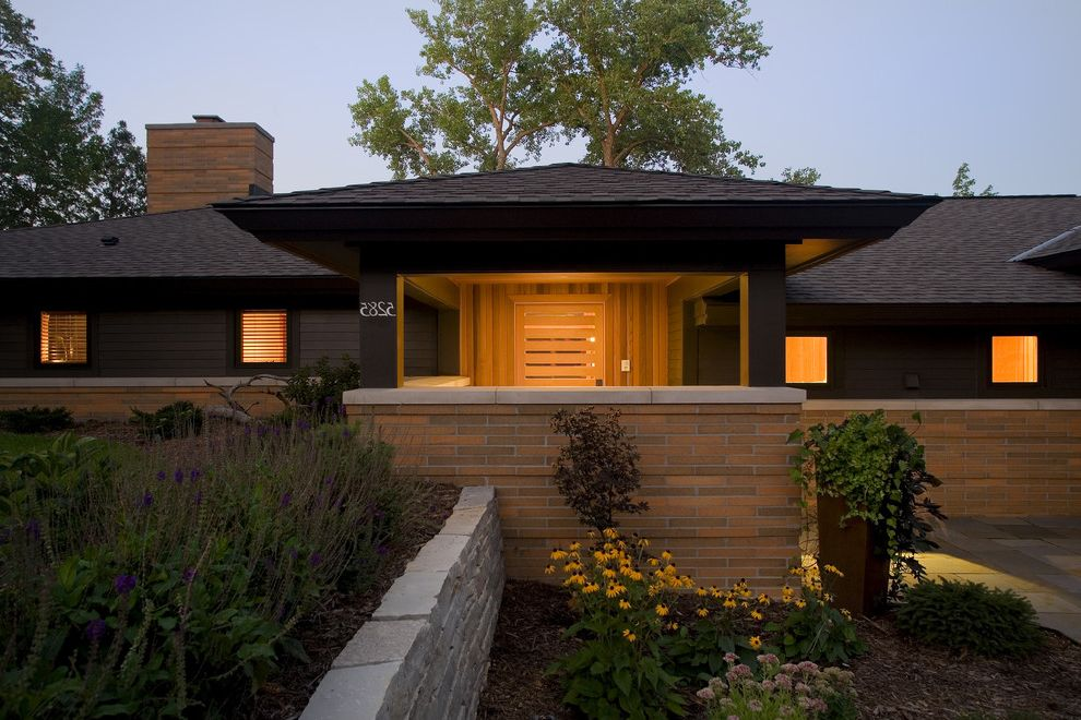 Hip Roof Construction   Contemporary Exterior Also Black Shingled Roof Brick Chimney Brick Wall Covered Porch Entry Hip Roof Landscape Landscaping Low Roof Retaining Wall Roof Overhang Slotted Door Square Windows Stacked Stone Wall Wood Siding