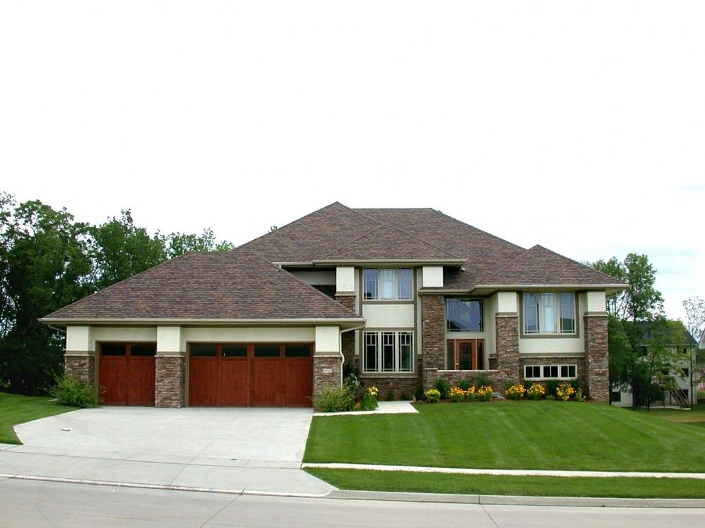 Hip Roof Construction with Contemporary Exterior  and Driveway Entrance Entry Garage Door Grass Lawn Path Stone Siding Turf Walkway Wood Garage Door