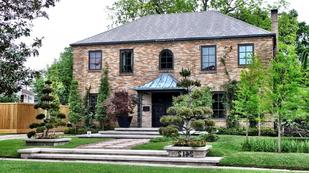 Hip Roof Construction with Traditional Exterior Also Address Numbers Brick House Curb Appeal Driveway Exterior Front Sidewalk Hip Roof House Numbers Landscape Lawn Metal Portico Ornamental Trees Patio Potted Plants Stepping Stones Terraced Wide Stairs