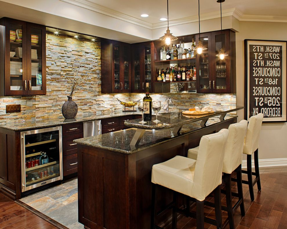 Home Bar Ice Maker with Traditional Home Bar  and Dark Wood Cabinets Glass Front Cabinets Home Bar Pendant Lighting Stone Backsplash Undercabinet Lighting Wet Bar Wood Floors