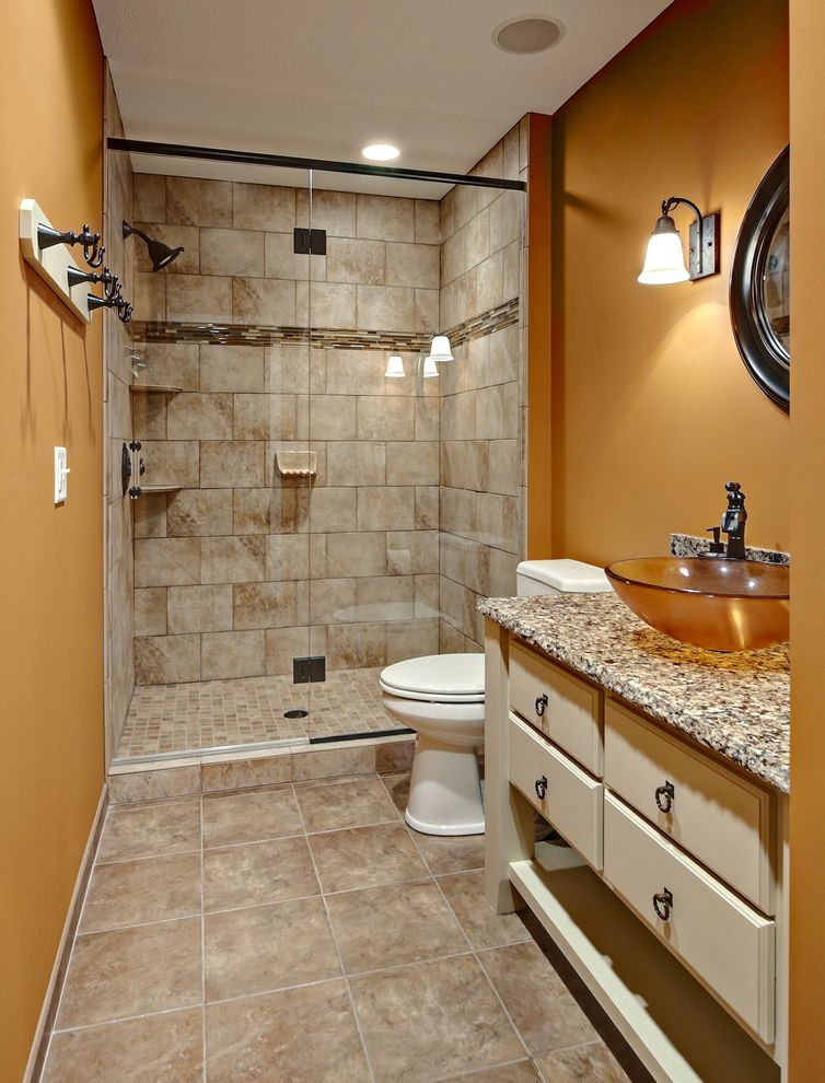 Home Construction Cost Estimator   Traditional Bathroom Also Bathroom Lighting Earth Tone Colors Floor Tile Freestanding Vanity Glass Shower Door Golden Walls Sconce Shower Tile Small Bathroom Towel Rack Vessel Sinks Wall Lighting