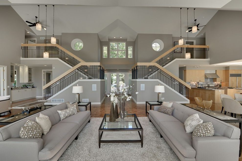 Home Depot Durham   Contemporary Living Room Also All Gray Glass Coffee Table Gray and White Gray Couch Gray Rug High Ceiling Oculus Windows Two Staircases