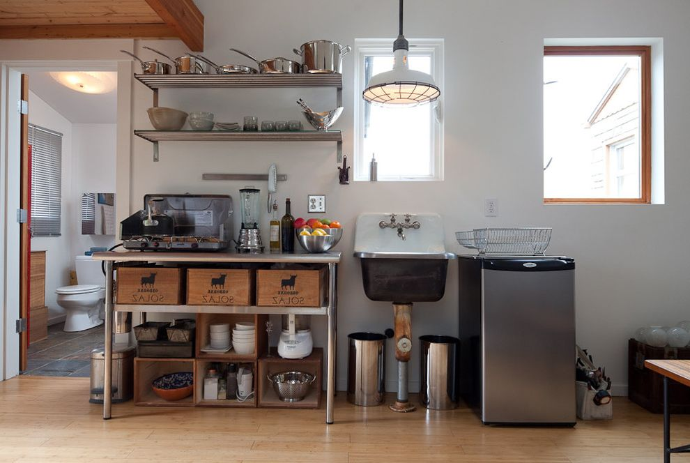Home Depot Metal Shelving   Eclectic Kitchen  and Industrial Pendant Light Kitchen Cart Metal Shelves Open Shelves Open Shelving Pendant Light Sink Small Kitchen Stainless Steel Table Wall Mounted Faucet Wall Mounted Sink White Walls Wood Floor Wood Trim
