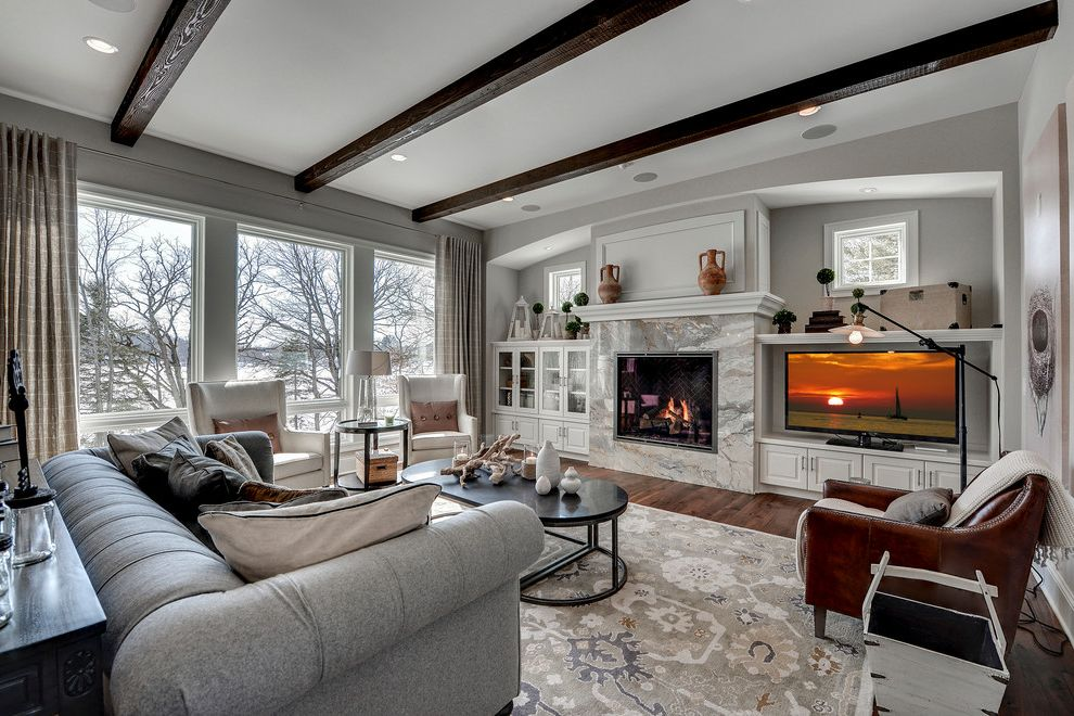 Home Depot Sisal Rug   Traditional Living Room  and Arch Beams Built in Cabinets Coffee Table Curtain Dark Wood Fireplace Gray Couch Gray Walls High Ceiling Large Area Rug Mantle Muntins Nook Picture Windows Recessed Lights White Trim Wood Floors