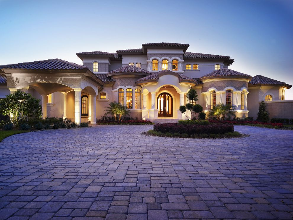 Home Elevator Cost   Mediterranean Exterior Also Circular Columns Covered Entry Criss Crossing Curved Fence Flowers Garden Grass Hardscape Hip Roof Landscape Lawn Muntins Path Pavers Plants Roof Tile Steps Stucco Trees Walkway Windows