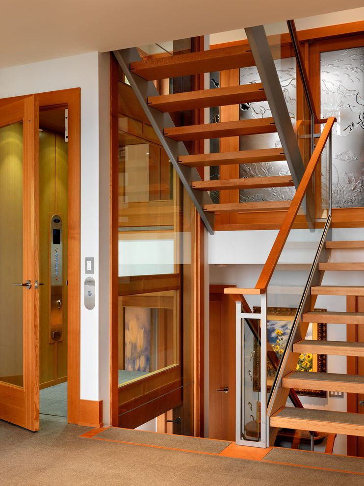 Home Elevator Cost with Contemporary Staircase Also Baseboards Elevator Glass Railing Open Risers Stair Landing Wood Trim