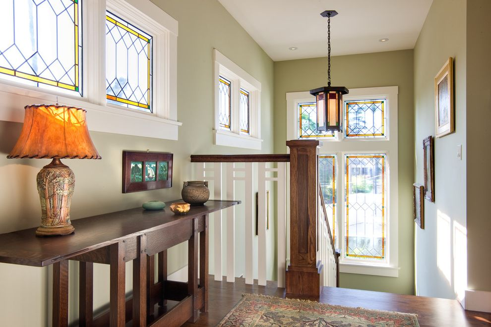 Home Goods San Diego   Craftsman Staircase  and Dark Wood Console Table Framed Art Green Walls Pendant Light Stained Glass Windows
