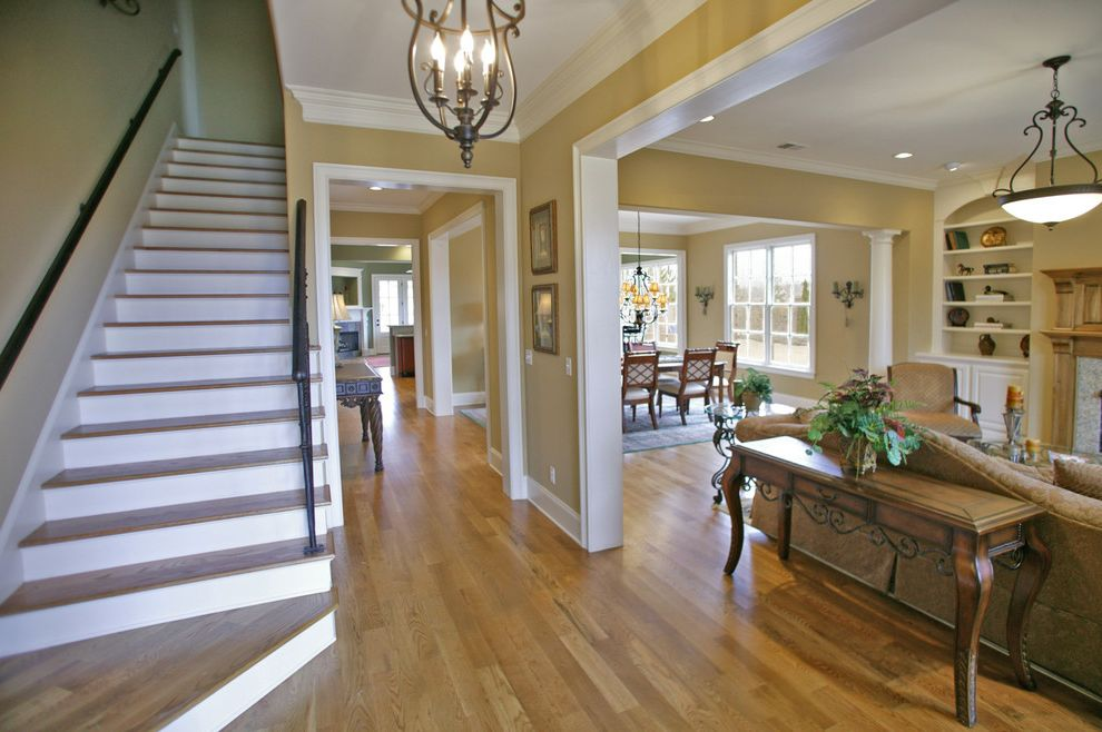 Home Inspection Memphis Tn   Traditional Entry  and Beige Wall Built in Bookshelf Console Table Fireplace Staircase Traditional Sofa White Column White Molding White Trim Wood Floor Wood Staircase