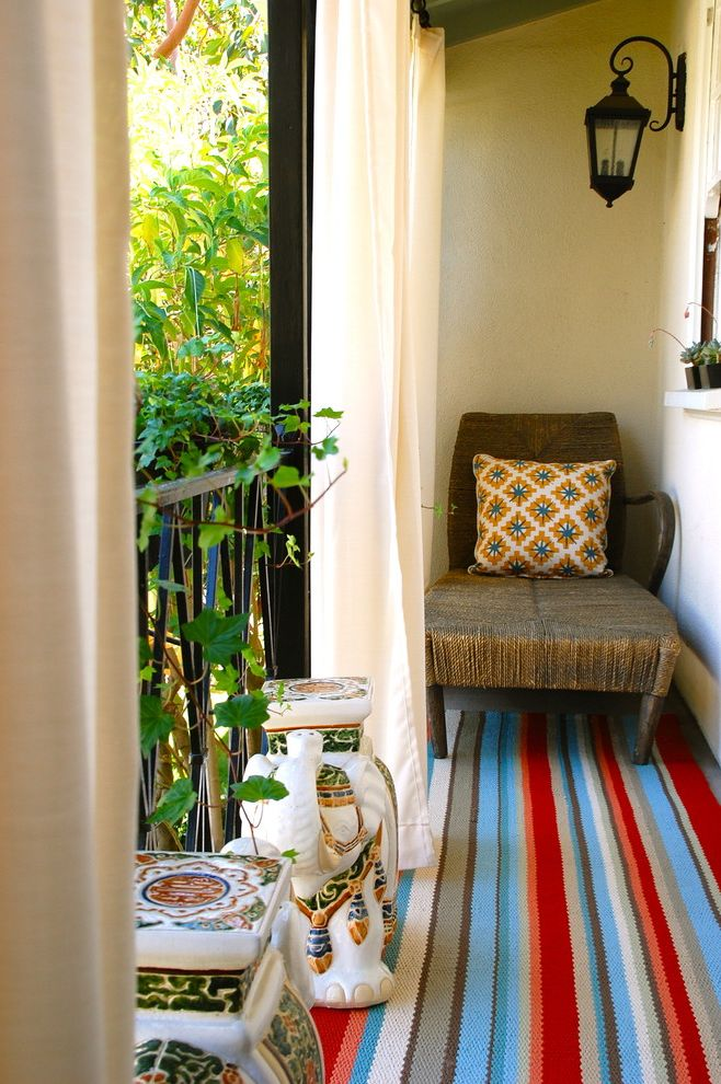 Homegoods Rugs   Eclectic Balcony  and Area Rug Bold Colors Bright Colors Decorative Pillows Elephants Handrail Lantern Metal Railing Outdoor Curtains Outdoor Cushions Outdoor Lighting Outdoor Rug Patio Furniture Small Stripes Throw Pillows