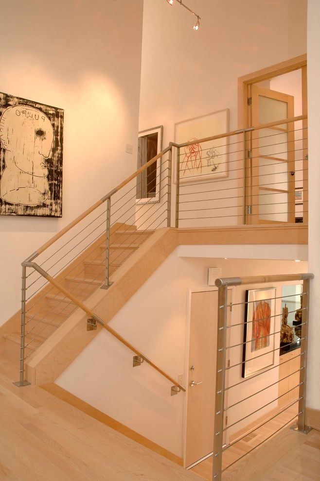 Homemakers Des Moines   Contemporary Staircase  and Cable Railing Contemporary Artwork Framed Artwork High Ceilings Neutral Color Scheme Split Level Design Track Lighitng Wood Framed Doors Wooden Hand Rail
