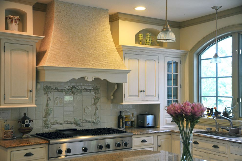 Hoods St Louis with Mediterranean Kitchen Also Arch Window Bulk Head French Granite Counters Island Pendant Lights Range Hood Stainless Steel Appliances Tile Backsplash White Cabinets