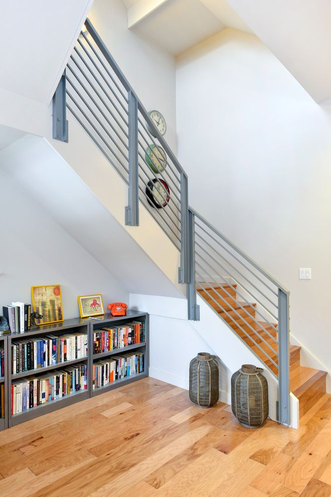 Horizontal Bookshelf   Contemporary Staircase Also Bookcase Bookshelf Candle Lantern Clocks Horizontal Bookcase Horizontal Bookshelf Leed Metal Railing Metal Stair Railing Modern Prefab White Wall Wood Floor Wood Staircase Wood Stairs
