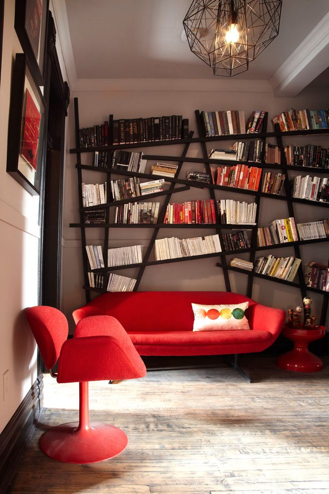 Horizontal Bookshelf with Contemporary Family Room  and Accent Table Black Casing Black Frames Books Bookshelf Crown Molding Light Gray Modern Furniture Pillow Red Sofa Urban Vintage Wire Pendant Light Wood Floor
