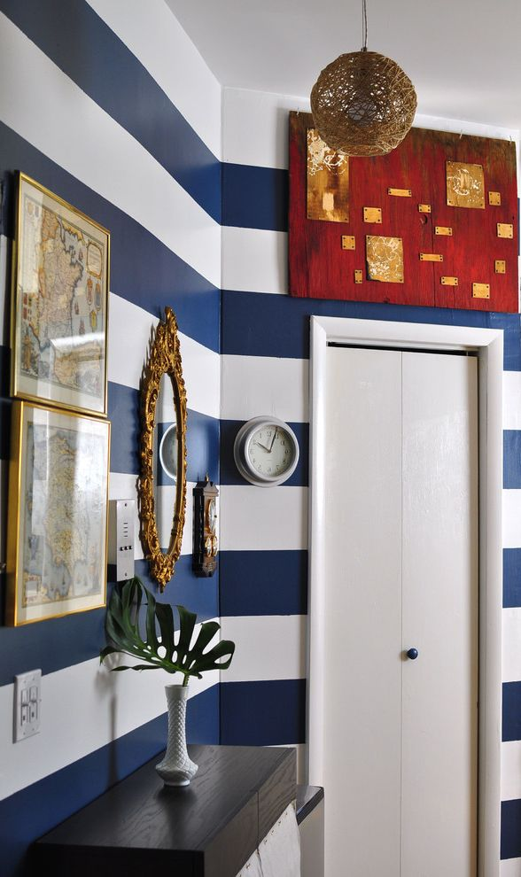 Horizontal Striped Drapes with Eclectic Entry and Art Blue and White Gallery Wall Hall Hallway Horizontal Stripes Milk Glass Painting Pendant Lighting Red Accents Vintage Maps Wall Art Wall Decor Wall Stripes