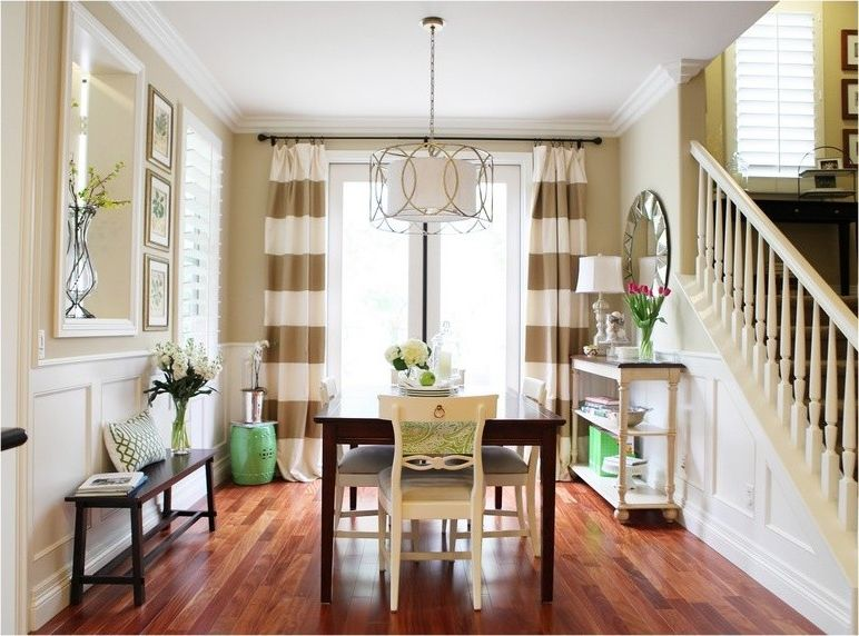 Horizontal Striped Drapes with Traditional Dining Room and Bench Chandelier Dark Table Dining Room Drum Shade Eating Area French Doors Garden Stool Green Green Accents Mirror Striped Drapes White Chairs
