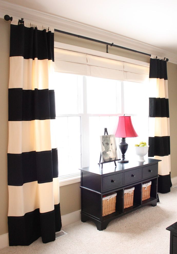 Horizontal Striped Drapes with Traditional Family Room and Baseboards Console Table Crown Molding Curtains Drapes Horizontal Stripes Neutral Colors Storage Baskets White Wood Wicker Baskets Window Treatments Wood Trim