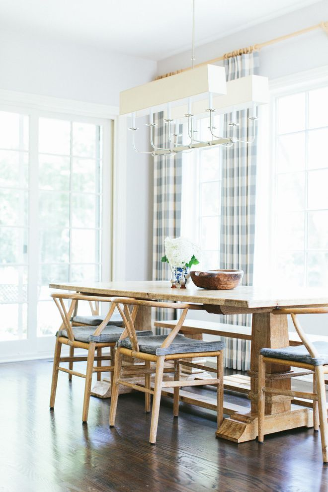 Horizontal Striped Drapes with Transitional Dining Room and China Vase Farmhouse Dining Table Floral Arrangment Formal Dining French Doors Gingham Pattern Gray Walls Rustic Dining Table Striped Curtains Wishbone Chair Wood Bowl Wood Dining Table