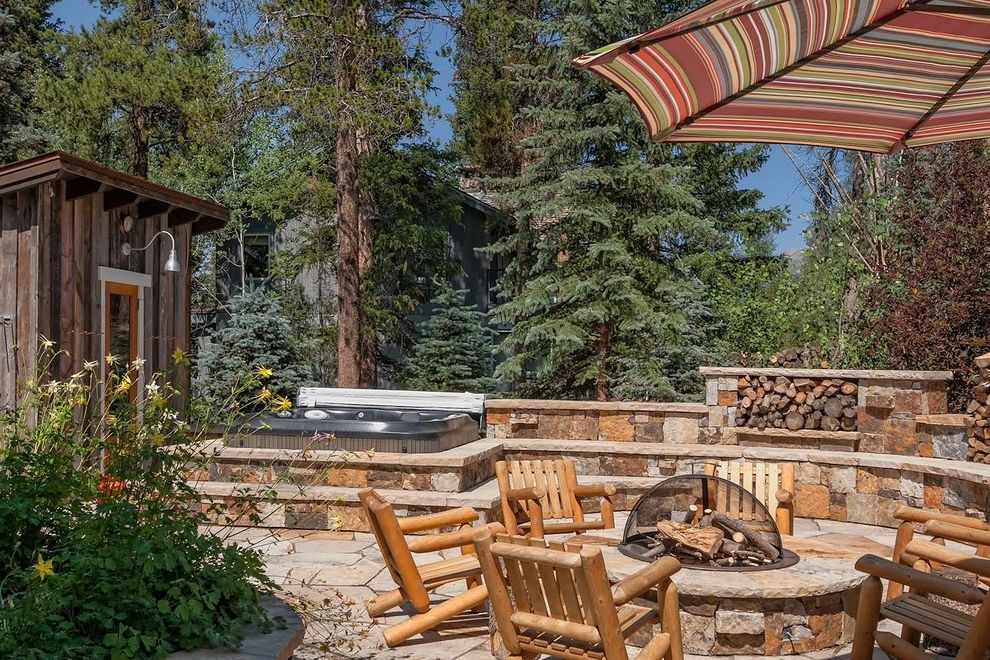 Hot Tub in Garage   Rustic Deck  and Barn Light Fire Screen Firepit Gooseneck Light Hot Tub Jacuzzi Log Furniture Low Garden Wall Patio Umbrella Steps Stonework