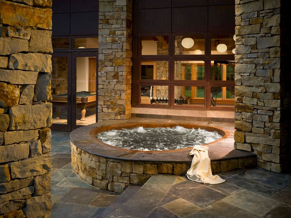 Hot Tub in Garage with Contemporary Pool Also Built in Covered Patio Hot Tub Lodge Patio Paving Pavers Spa Stone Paving Stone Pillars