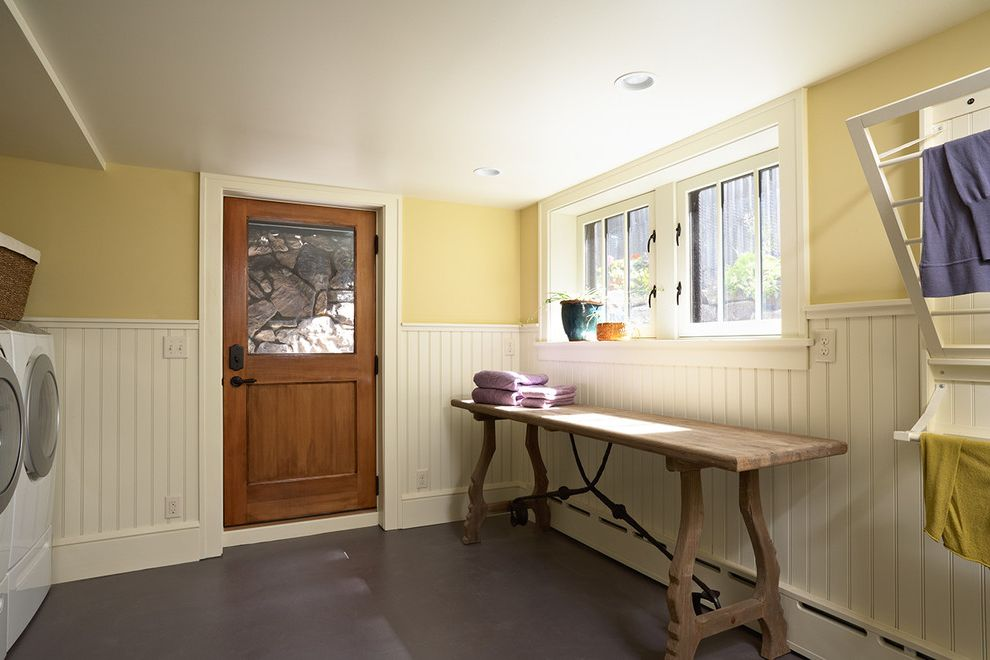 Hot Water Baseboard Covers   Craftsman Laundry Room Also Baseboard Radiator Bead Board Wainscot Built in Drying Rack Drying Rack Front Loading Laundry Painted Concrete Floor Wainscot Wainscoting Yellow