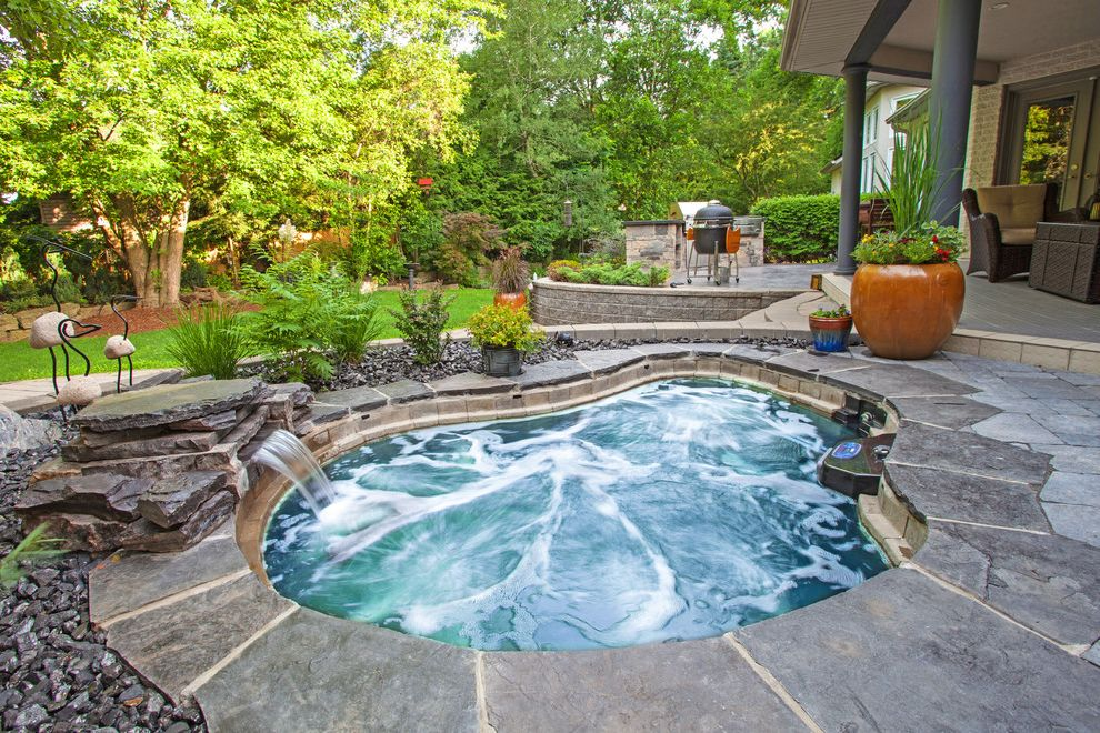 Hot Water Baseboard Covers with Traditional Pool  and Column Covered Deck Grass Hot Tub Lawn Natural Stone Pavers Outdoor Bbq Outdoor Grill Outdoor Potted Plants Pillar Rock Landscape Stone Patio Stone Pavers Water Feature Water Fountain