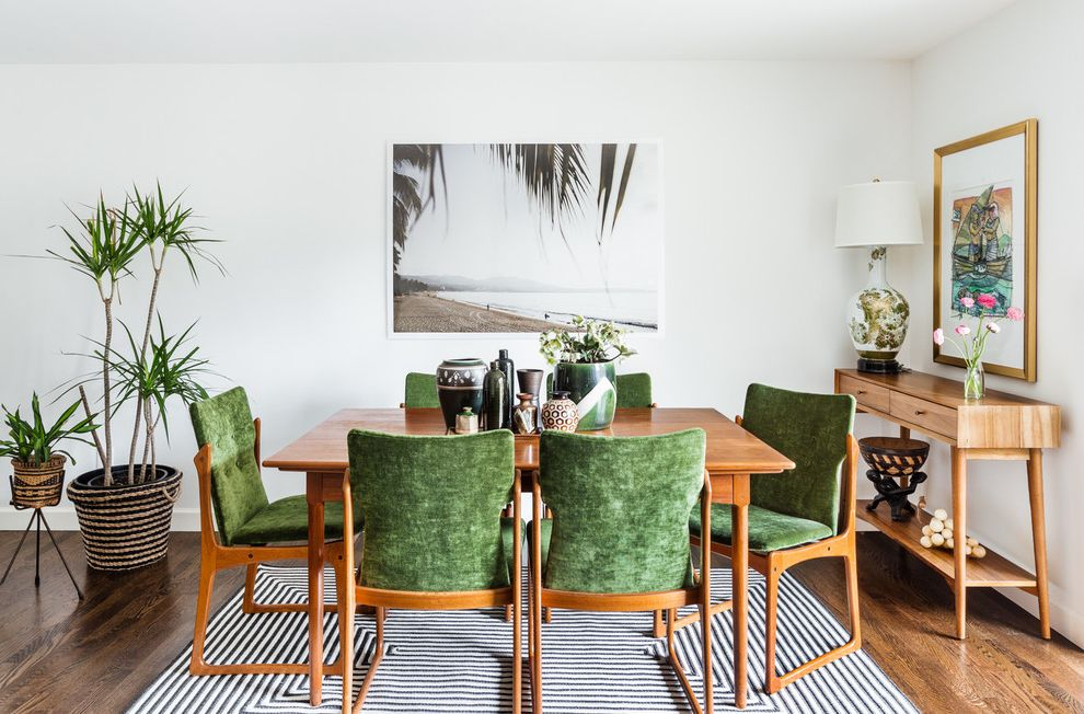 House of Tropicals   Tropical Dining Room  and Beach House Global Style Green Chairs Green Velvet High Contrast Interior Midcentury Modern House School House Electirc Tropical House White Walls Wood Floors