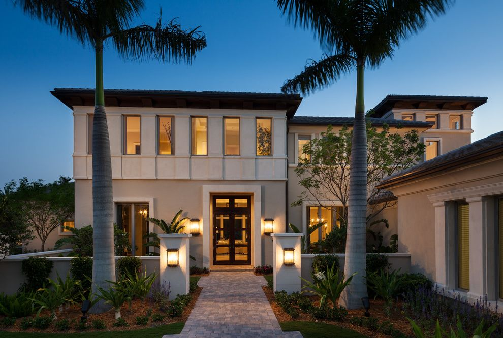 House of Tropicals with Transitional Exterior  and Florida Glass Door Outdoor Lighting Palm Trees Paved Sidewalk Pavers Tropical Landscaping Tropical Plants Wall Sconces