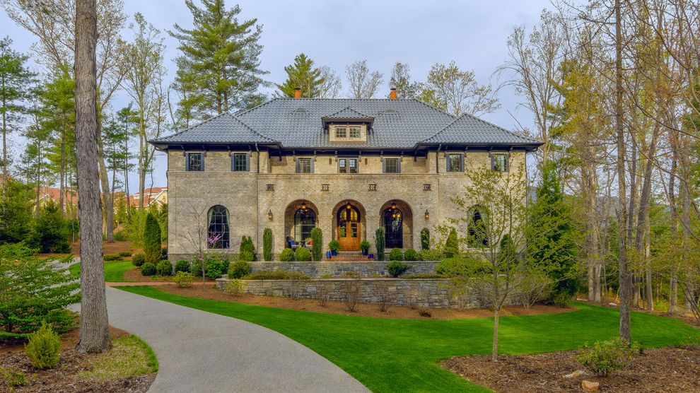 Housemaster Home Inspection Reviews   Traditional Exterior Also Arched Windows Archways Dormer Window Grass Landscaping Lawn Retaining Wall