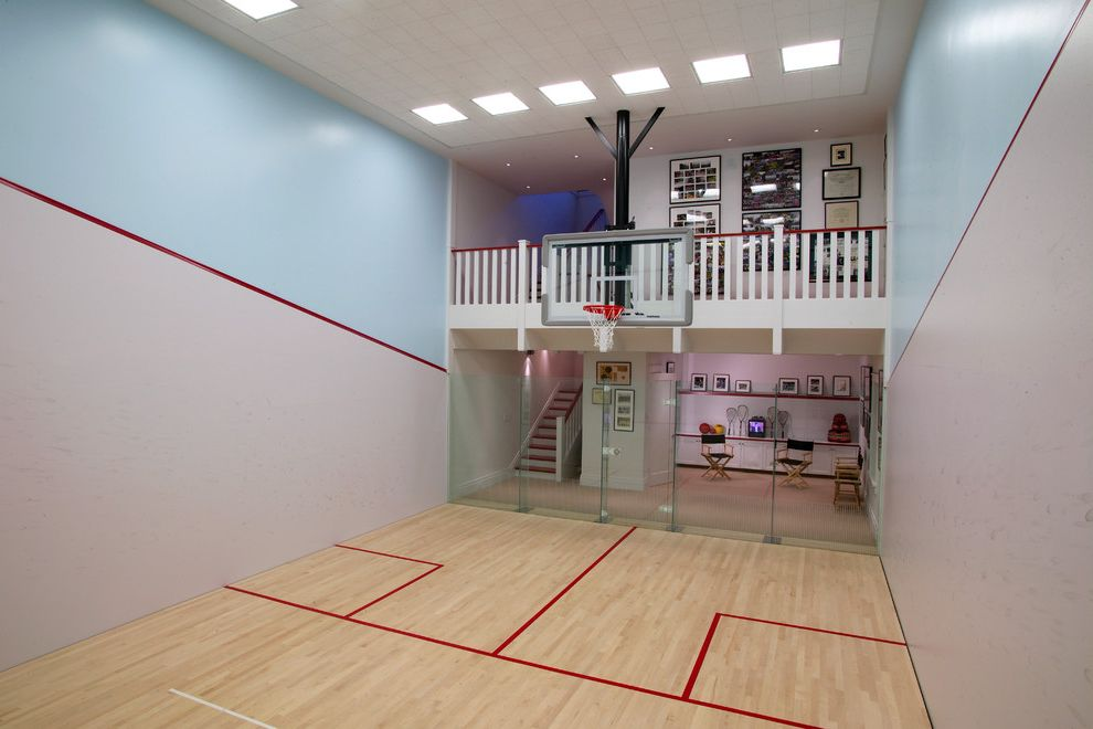 How Big is a Basketball Court   Traditional Home Gym Also Basketball Court Ceiling Lights Directors Chair Glass Door Glass Wall Gray Wall Hanging Basketball Hoop Indoor Basketball Indoor Basketball Court Light Blue Wall Red Striped Wall White Railing