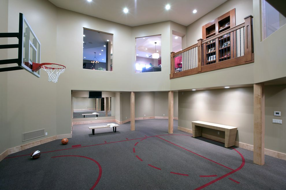 How Big is a Basketball Court with Contemporary Home Gym Also Balcony Basketball Beige Bench Seat Carpeting Console Loft Ceiling Posts Recessed Lights Sports Court Wood Baseboard Wood Railing