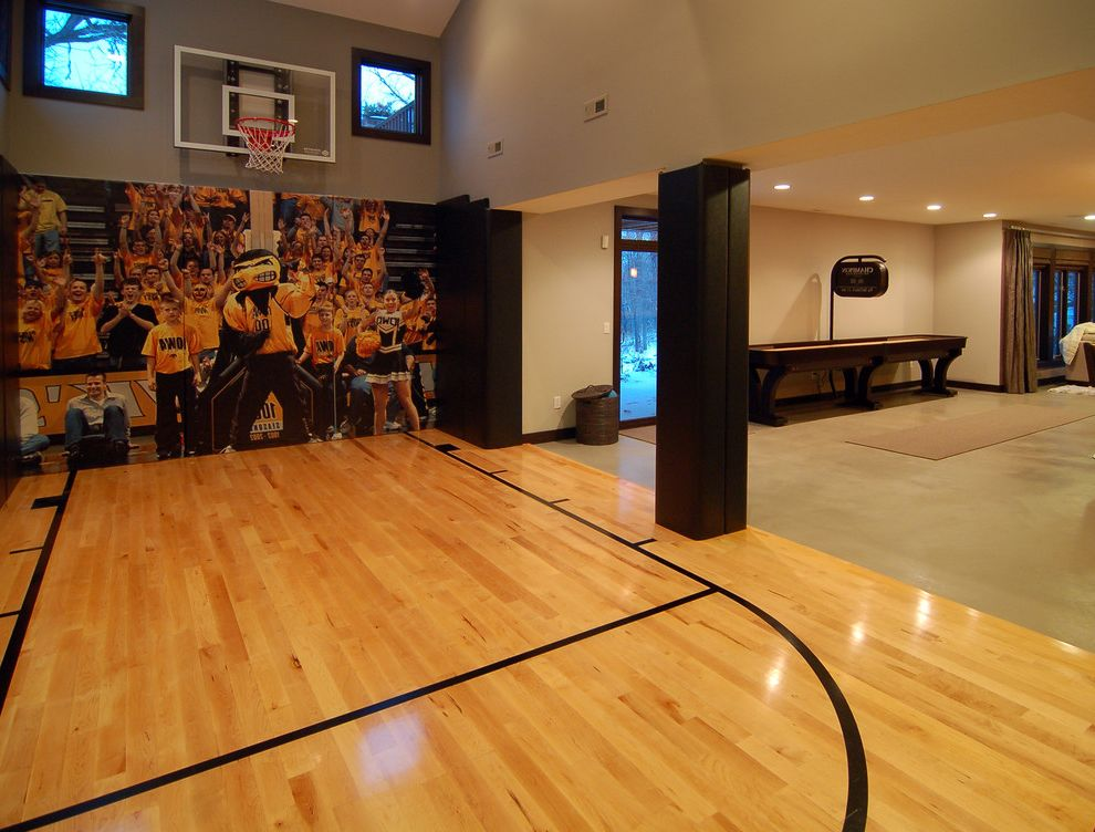 How Big is a Basketball Court with Modern Home Gym Also Basketball Court Clerestory Windows Dark Painted Trim Gray Hoop Interior Sport Court Mural Natural Wood Scoreboard Wood Floor