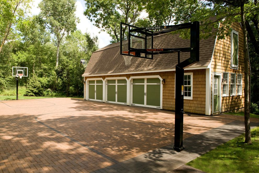 How Big is a Basketball Court with Traditional Shed  and Barn Garage Basketball Court Basketball Standard Brick Brick Court Driveway Garage Green Garage Doors Herringbone Pattern Kids Paver Pavers Shakes Sports Teens White Trim