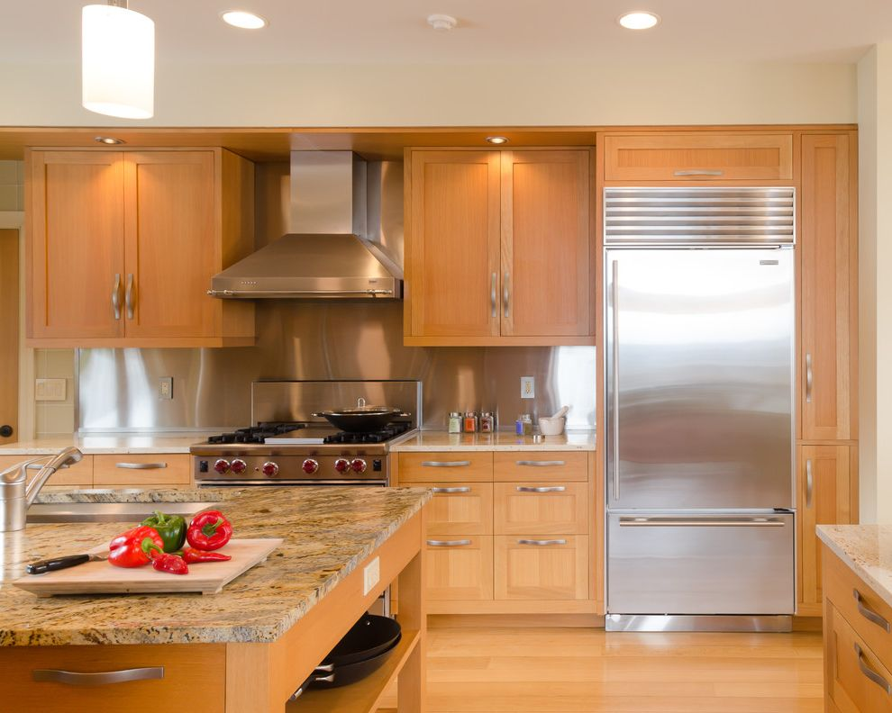 How Long Do Refrigerators Last with Contemporary Kitchen  and Ceiling Lighting Kitchen Island Light Wood Cabinets Metal Sheet Backsplash Recessed Lighting Shaker Cabinets Stainless Steel Appliances Stainless Steel Backsplash Wood Floors