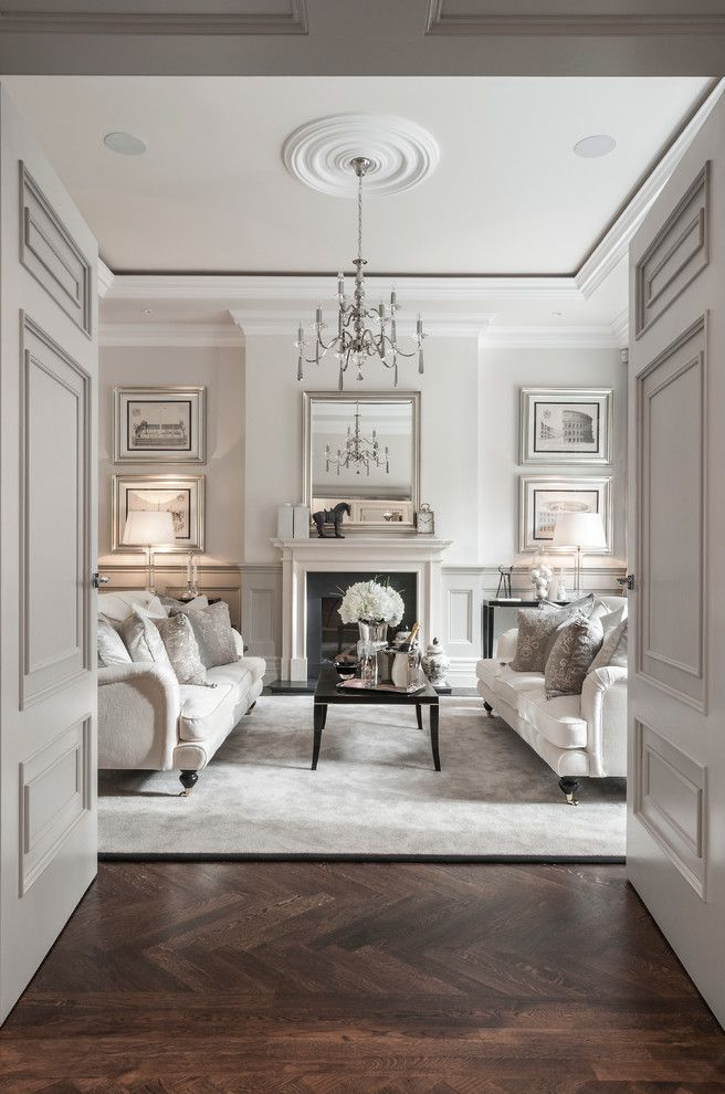 How Long Does It Take to Paint a Room with Traditional Living Room  and Art British Chandelier Cream Doors Fireplace Large Living Room Luxury Parquet Posh Rug Traditional Wainscoting White Rug White Sofa Wood Floor