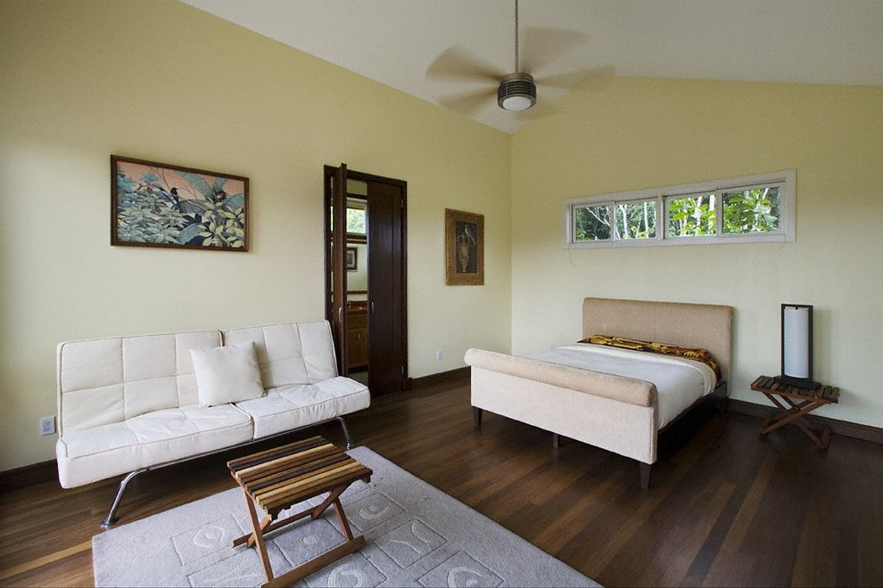 How Much Are Futons with Tropical Bedroom Also Area Rug Baseboards Bedside Table Ceiling Fan Clerestory Dark Floor Futon Neutral Colors Sleeper Sofa Sloped Ceiling Upholstered Headboard Vaulted Ceiling Wall Art Wall Decor Wood Flooring Wood Trim