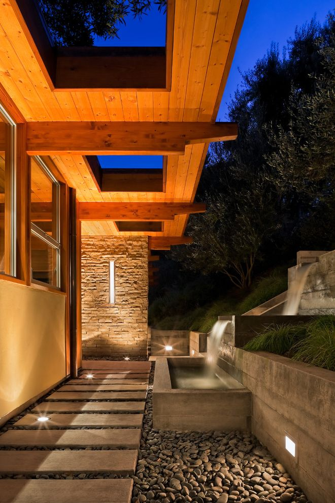 How Much Does an Architect Make   Contemporary Landscape Also Cut Outs Mid Century Modern Mountain View Patio Pebbles Rafters Side Yard Stepping Stones Water Feature Waterfall Wood Soffit Lining