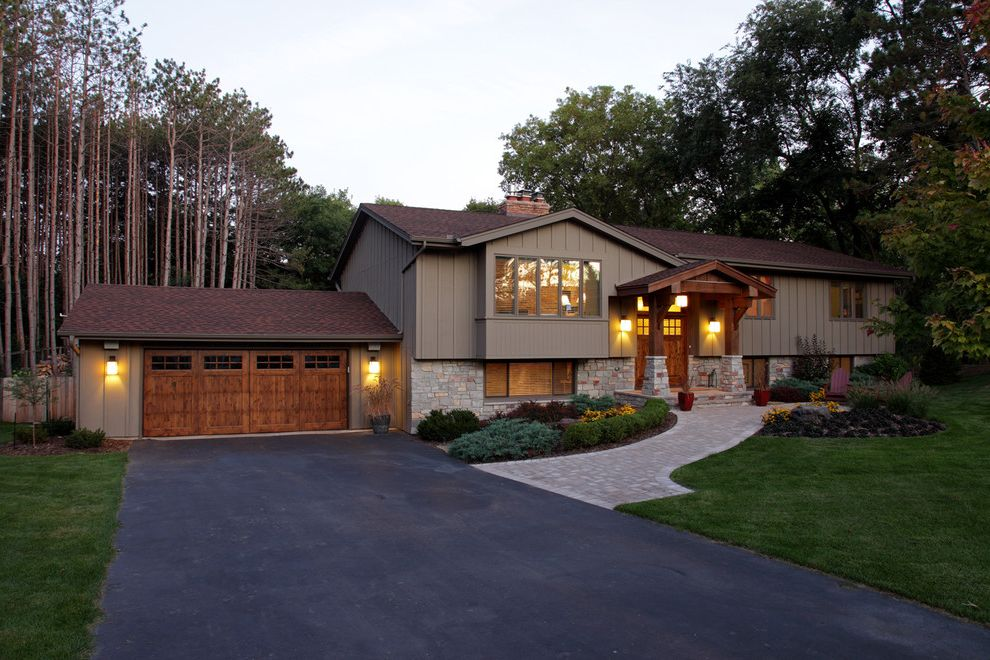How Much Does an Asphalt Driveway Cost with Traditional Exterior  and Asphalt Bead Board Board and Batten Carriage Doors Covered Entry Front Yard Gable Roof Lawn Path Pavers