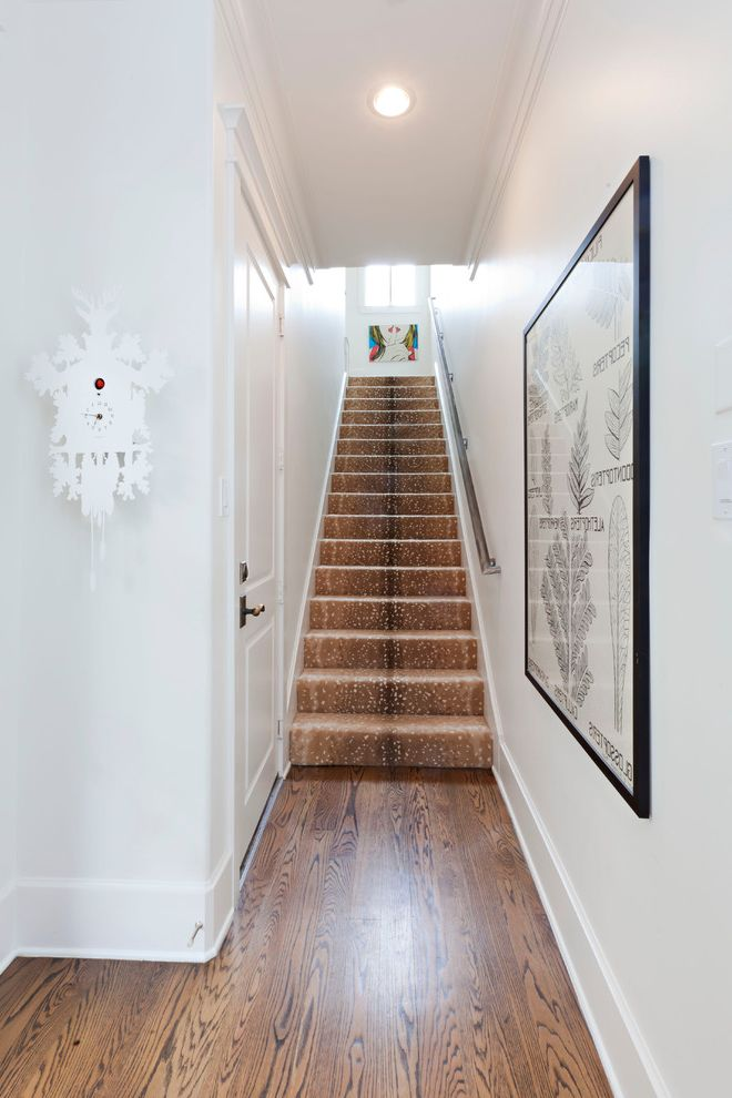 How Much Does It Cost to Carpet Stairs with Transitional Staircase Also Artwork Baseboard Bright Clean Crown Molding Cuckoo Clock Light Raised Panel Woodwork Staircase Carpeting White Walls Wood Floor Wood Grain