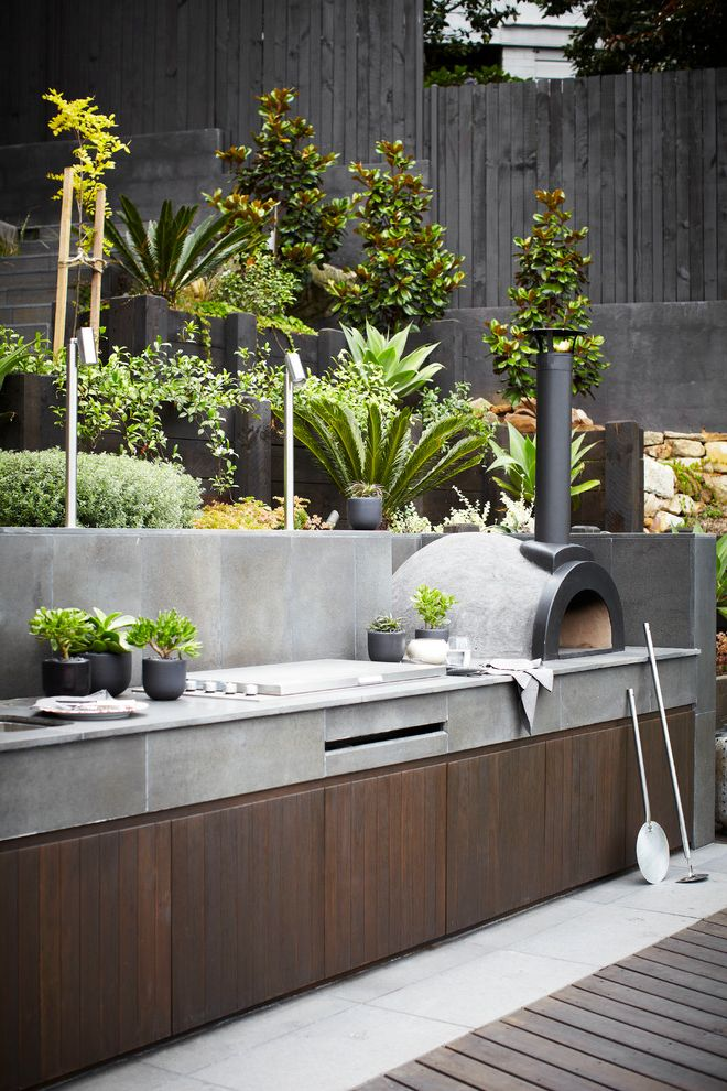 How Much Does It Cost to Remodel a Kitchen with Contemporary Patio  and Bbq Dark Wood Garden Landscape Design Outdoor Dining Outdoor Living Plants Pots Rass Sydney