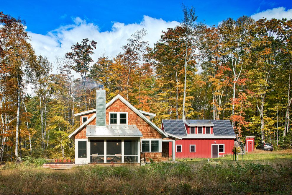 How Much Does Solar Panels Cost with Farmhouse Exterior  and Autumn Barn Exterior Exterior Stairs Lake House Metal Railing Metal Roof Modern Farmhouse Outdoor Shower Outhouse Retreat Home Roof Screened Porch Solar Panel White Window Trim Windows Woodsy