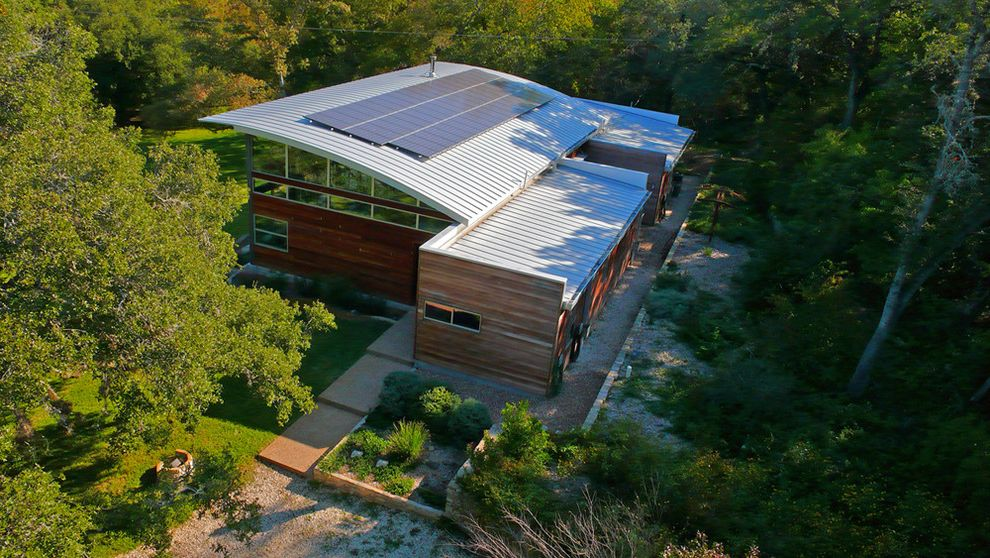 How Much Does Solar Panels Cost with Modern Exterior  and Aerial View Aluminum Arched Roof Clerestory Windows Landscaping Lawn Solar Panels Transom Windows Wood Siding Woods Yard