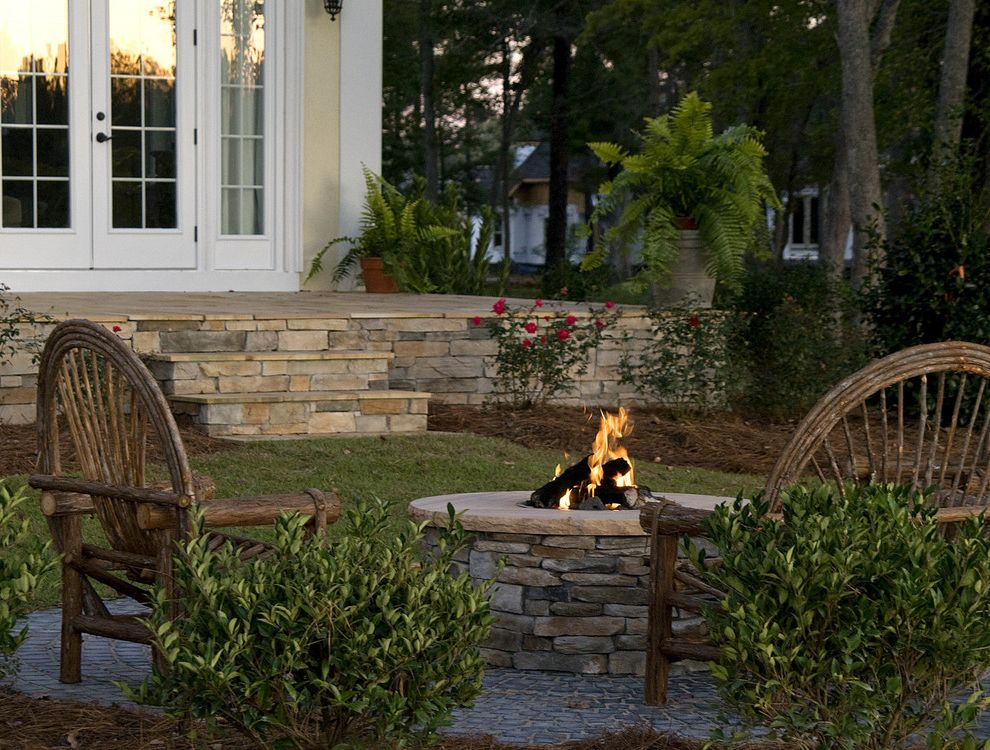 How to Build a Gas Fire Pit   Mediterranean Patio Also Fire Pit Gravel Patio Furniture Shrubs Willow Furniture