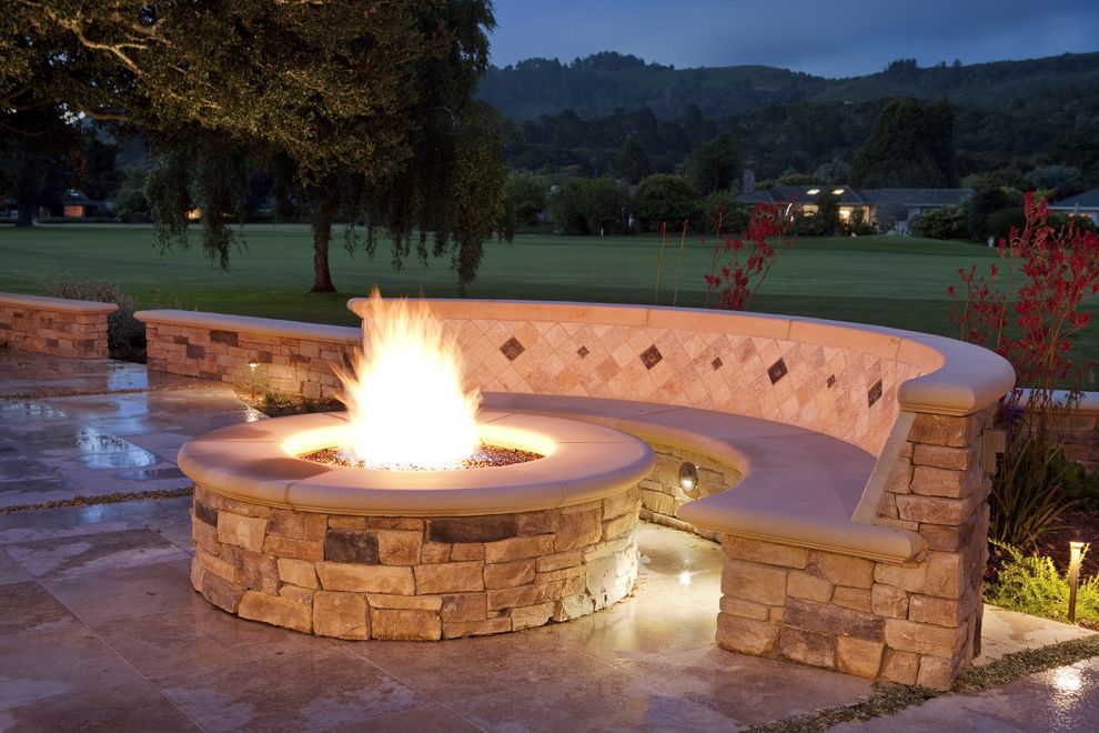 How to Build a Gas Fire Pit with Traditional Patio Also Bench Curve Firepit Fuel Burning Landscape Lighting Lawn Mosaic Stacked Stone Stone Travertine