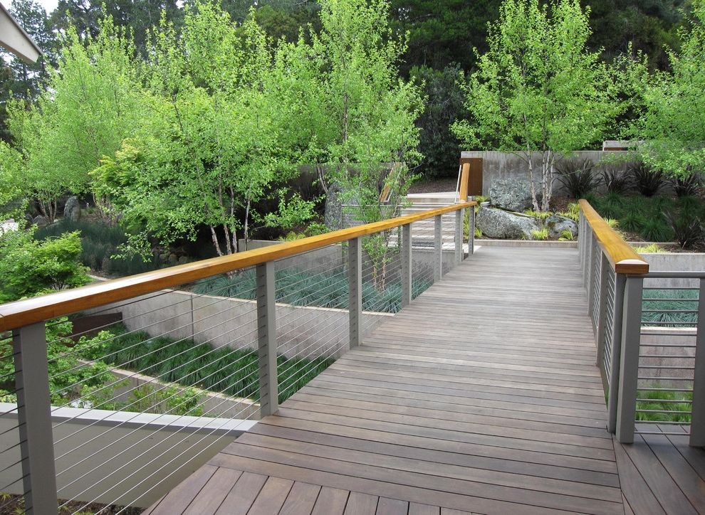How to Build a Wheelchair Ramp   Contemporary Landscape Also Bridge Concrete Retaining Walls Deck Entrance Entry Geometric Geometry Grass Handrail Hillside Neutral Colors Path Planters Ramp Slope Steel Cable Railing Terrace Walkway Wood Flooring