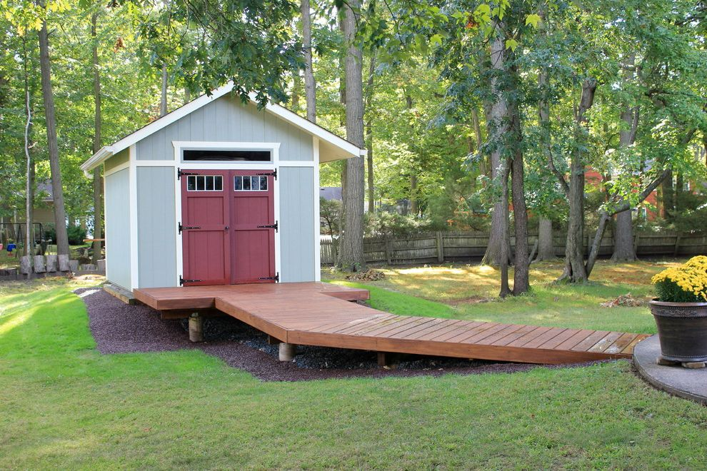 How to Build a Wheelchair Ramp   Traditional Shed Also Boardwalk Bridge Elevated Elevated Walkway Grass Gravel Gray Shed Lawn Outdoor Potted Plant Raised Shed Raised Walkway Red Door Red Shed Door Shed Storage Trees Wood Fence Yellow Flowers