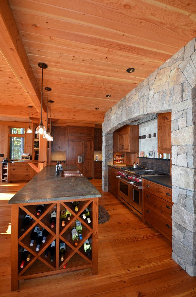How to Build a Wine Rack in a Cabinet   Traditional Kitchen Also Curve Gourmet Appliances Gourmet Kitchen Gray Counters Kitchen Kitchen Island Large Range Niche Open Plan Pendant Lights Stone Wall Tile Backsplash Wine Rack Wine Storage Wood Ceiling