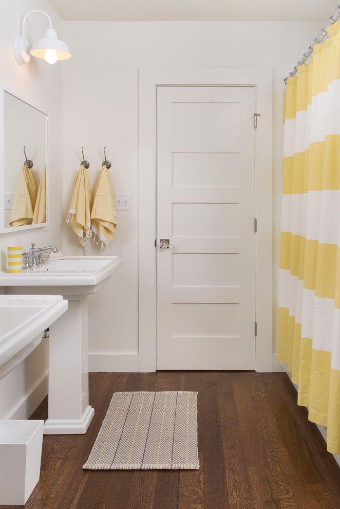 How to Change a Door Knob   Contemporary Bathroom  and Barn Lamp Baseboards Bath Mat Panel Door Pedestal Sinks Shared Bathroom Small Bathroom Striped Shower Curtain Towel Hooks White Wood Wood Floors Wood Trim