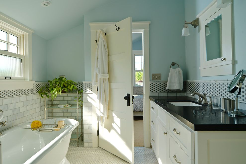 How to Change a Door Knob with Craftsman Bathroom  and Bathroom Blue Blue Walls Cabinetry Counter Tagre Five Panel Door Freestanding Bathtub Medicine Cabinet Mirror Sinke Subway Tile Tile Tile Stripe White Door